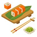Sushi roll Philadelphia with wasabi, cream cheese, chopsticks, wood board. Royalty Free Stock Photo