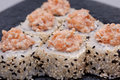 Sushi roll on a plate black close up Royalty Free Stock Photo