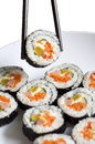 Sushi roll on plate with chopsticks Stock Photography