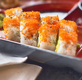 Sushi roll with red caviar closeup Royalty Free Stock Photo