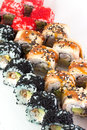 Sushi roll with red tobiko and canada sushi roll with sesame black Royalty Free Stock Photos