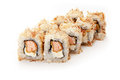 Sushi roll rolls on a white background sprinkled with tuna Stock Photography