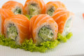 Sushi roll salmon philadelphia on a wooden plate with wasabi Royalty Free Stock Photos