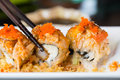 Sushi roll with salmon and shrimp tempura Royalty Free Stock Photo