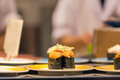 Sushi roll with sea urchin and seaweed Royalty Free Stock Photo