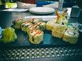 Sushi and sushi roll set on black table. Japanese Asian Traditional Food Set Sushi Rolls