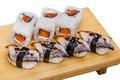 Sushi roll set and eel sashimi on a wooden desk Stock Photos
