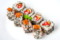 Sushi roll with shrimp, flying fish roe, salmon and black sesame Royalty Free Stock Photo