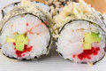 Sushi roll in tempura on white plate Royalty Free Stock Photography