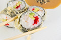 Sushi roll in tempura on white plate Royalty Free Stock Images