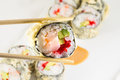 Sushi roll in tempura on white plate Stock Photos