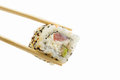 Sushi roll with tuna and sesame isolated on white background in chopsticks Royalty Free Stock Images