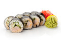 Sushi roll on a white background decorated with wasabi ginger and lemon Royalty Free Stock Photo