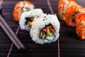 Sushi rolls assortment on bamboo mat Royalty Free Stock Photo