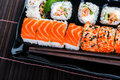 Sushi rolls assortment on black plate. Royalty Free Stock Photo