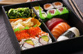 Sushi and rolls in bento box as closeup Stock Images