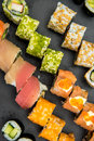 Sushi rolls on a black plate Royalty Free Stock Photo