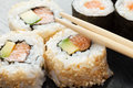 Sushi rolls on black wooden plate Royalty Free Stock Photo