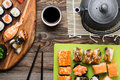 Sushi rolls with different fish and avocado, set of delicacies Royalty Free Stock Photo