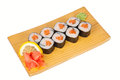 Sushi rolls with fresh salmon japanese on board isolated on white Stock Images