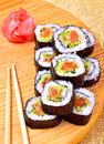 Sushi, rolls, ginger, chopstick on bamboo mat Royalty Free Stock Photo