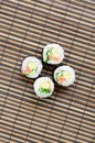 Sushi rolls lies on a bamboo straw serwing mat. Traditional Asian food. Top view. Flat lay minimalism shot with copy space