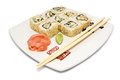 Sushi rolls on plate in group with chopsticks isolated white background Royalty Free Stock Images