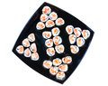 Sushi rolls with salmon and tomato on a black square plate isolated on white Stock Photography