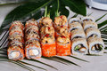 Sushi rolls set, appetizing, big, Philadelphia, salmon, masago, orange, hot, sauce, kimchi, sesame, smoked, cucumber, tropical, le Royalty Free Stock Photo