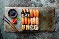 Sushi rolls set on stone slate Royalty Free Stock Photo