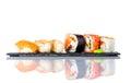 Sushi Rolls with Smoked Salmon on White Background Royalty Free Stock Photo