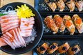 Sushi row wrapped with salmon and sliced fish sashimi,Japanese food Royalty Free Stock Photo