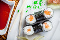 Sushi salmon and caviar rolls top view served on a plate Stock Photography