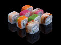 Sushi set allsorts with avocado shrimp tuna salmon and eel on black background Royalty Free Stock Images