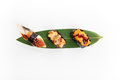Sushi set on banana leaves on a white background top view Royalty Free Stock Photography