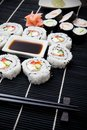 Sushi set on black bamboo mat Royalty Free Stock Photos