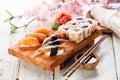 Sushi set sashimi and rolls on blue background Stock Photo