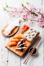 Sushi set sashimi and rolls on blue background Royalty Free Stock Photo