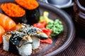 Sushi Set sashimi and sushi rolls served on dark plate. Image of Japanese food on dark background. Royalty Free Stock Photo