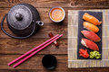 Sushi Set served on gray stone slate with soy sauce, grey teapot and cup of tea Royalty Free Stock Photo