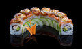 Sushi set with shrimp avocado and eel on black background Royalty Free Stock Images