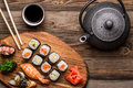 Sushi set, tea and soy sauce on wooden background Royalty Free Stock Photo