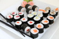 Sushi set traditional japanese food on white plate rolls Royalty Free Stock Images