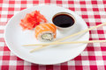 Sushi soy and ginger with chopsticks on a white plate Royalty Free Stock Photography