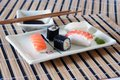 Sushi, soy sauce and wasabi on the table-cloth Royalty Free Stock Images