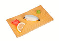Sushi with squid isolated on white plate wasabi and marinated ginger board Stock Photography