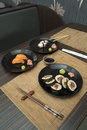 Sushi in sushi bar table and ration Royalty Free Stock Photos