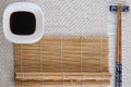 Sushi tools on white with bamboo mat Royalty Free Stock Photo