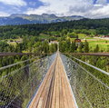 Suspended bridge over lama gorge in valais canton and between bellwald and ernenin switzerland Royalty Free Stock Photo