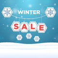 Suspended origami paper with the inscription sale and snowflake outside Stock Images